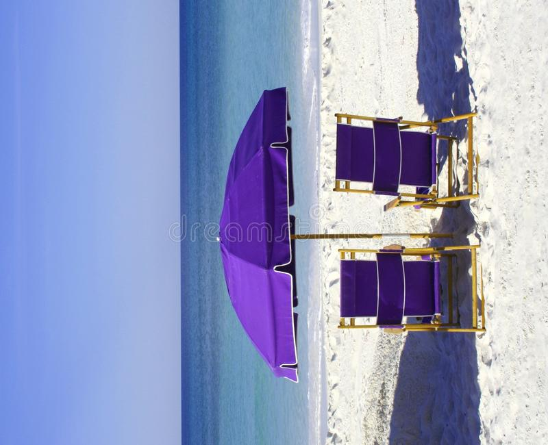 Free Purple Beach Chairs And Umbrella Royalty Free Stock Photography - 11018417