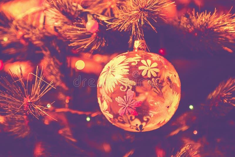 Purple beautiful glass ball on Christmas tree stock image