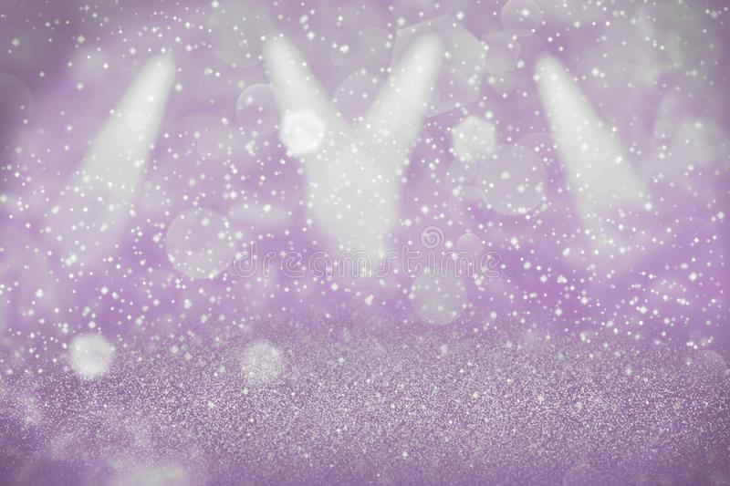 Purple beautiful glossy glitter lights defocused stage spotlights bokeh abstract background with sparks fly, festal mockup texture stock image