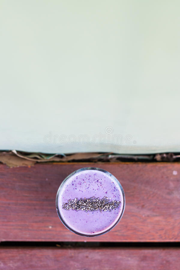 Purple berry soy smoothie with chia sprinkles. royalty free stock image