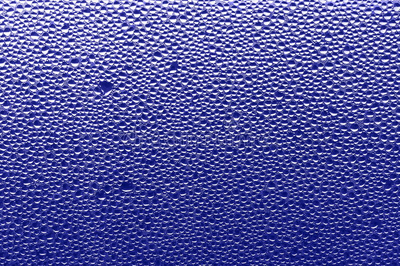 Purple blue background - water drops Stock Photos. Purple blue background - water drops : window after rain royalty free stock images