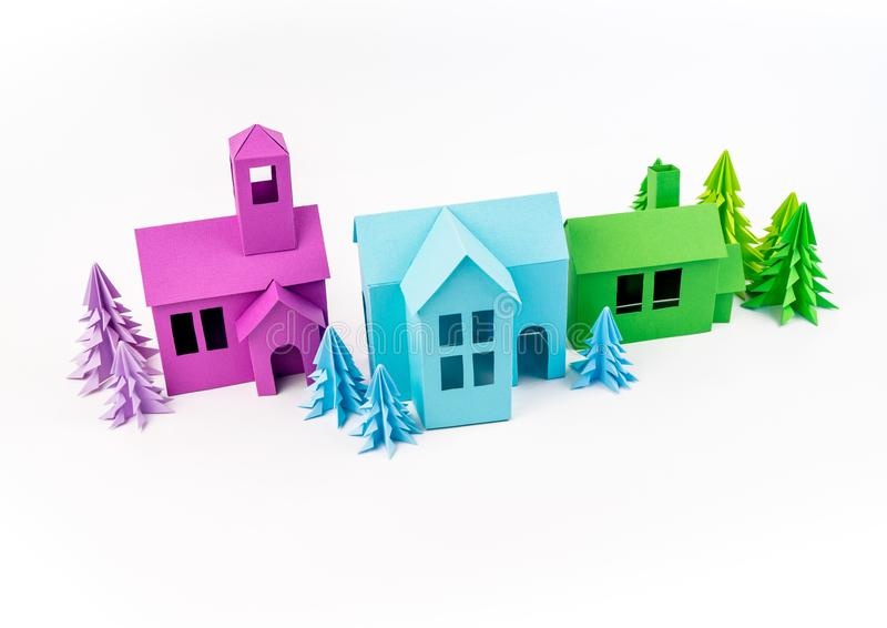Purple and blue green house glued out of paper stands in the Violet forest stock illustration