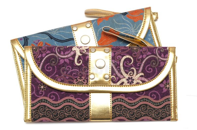 A purple and blue pouch with zipper puller royalty free stock images