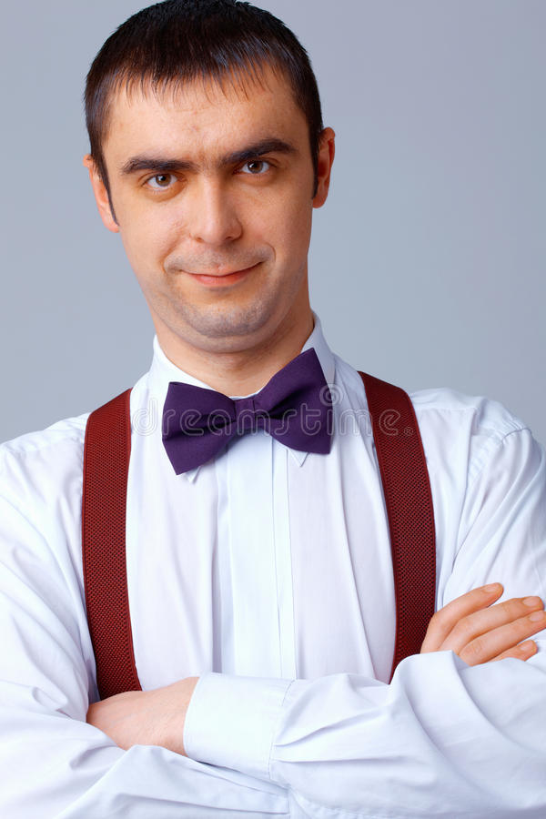 Purple Bow Tie And Brases. Royalty Free Stock Photography