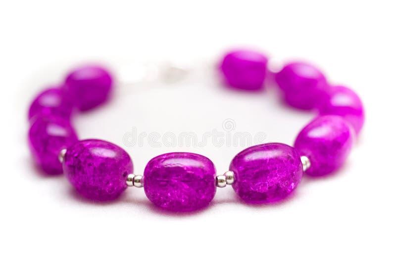 Purple bracelet stock photos