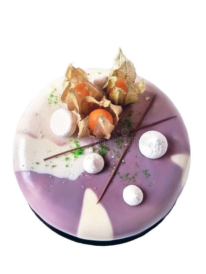 Purple cake with meringues and physalis berries royalty free stock photos