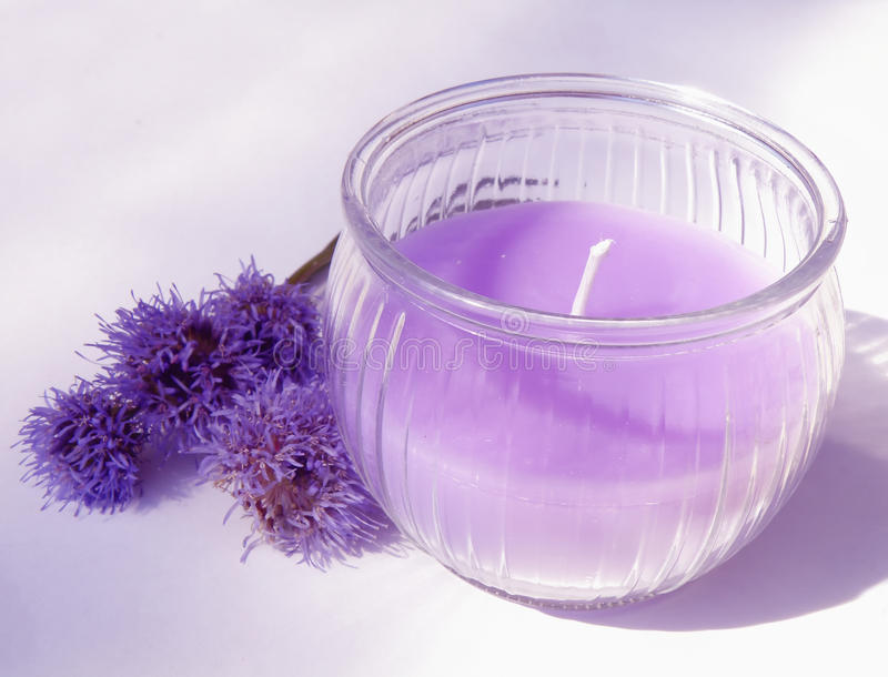 Purple candle royalty free stock image