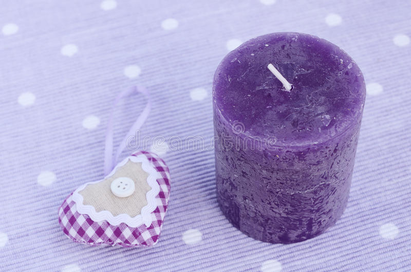 Purple candle and decorative aroma heart