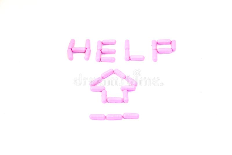 Purple capsules aranged in Text`Help` and arrow in health care f. Or help concept stock images