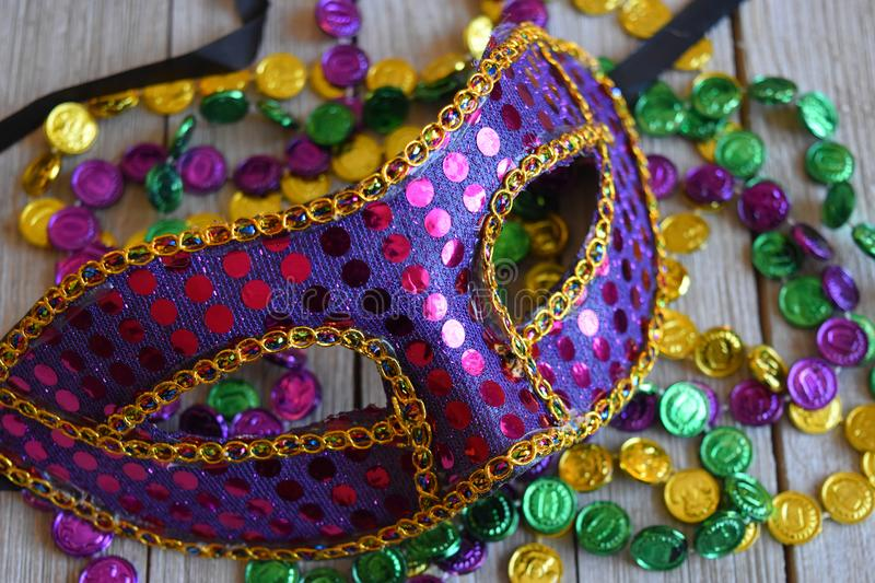 Sequined Mardi Gras mask with beads stock image