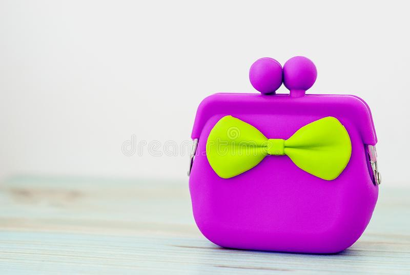 Purple cash wallet on wooden background. Charge purse royalty free stock photo