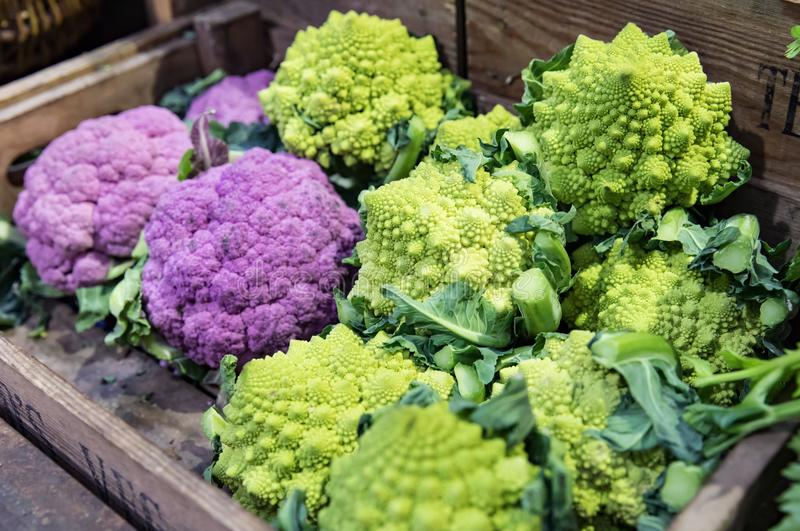 Purple cauliflower and Broccoflower at Market stock image