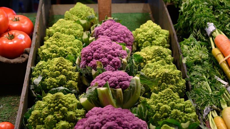 Purple cauliflower, romanesco, rainbow carrots and tomatoes stock image