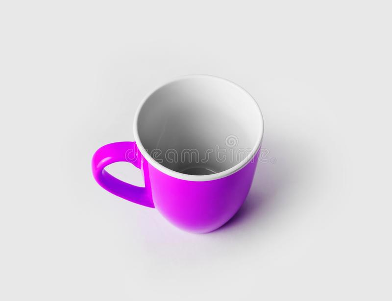 Purple ceramic cup. Or mug for coffee or tea stock photography