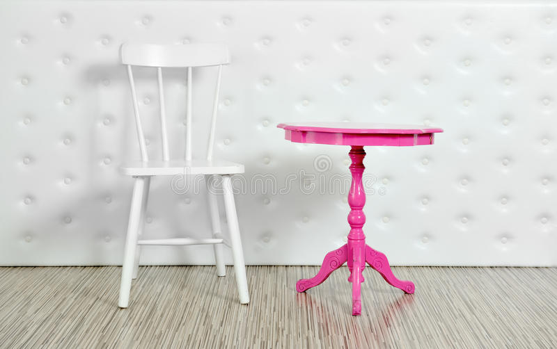 Purple chair and white table on a white background stock photos