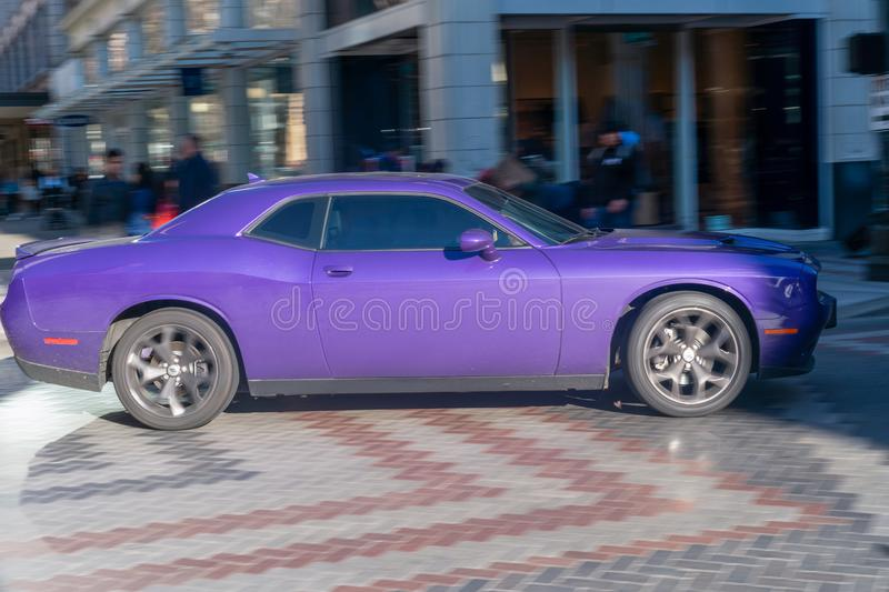 Purple Challenger in movement. Seattle, Washington - 2019-03-02 - Purple Challenger being driven in Seattle`s downtown street stock photos