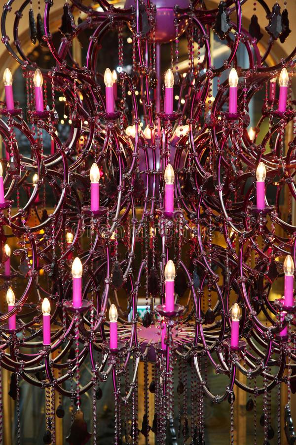 Purple chandelier with candles royalty free stock photo