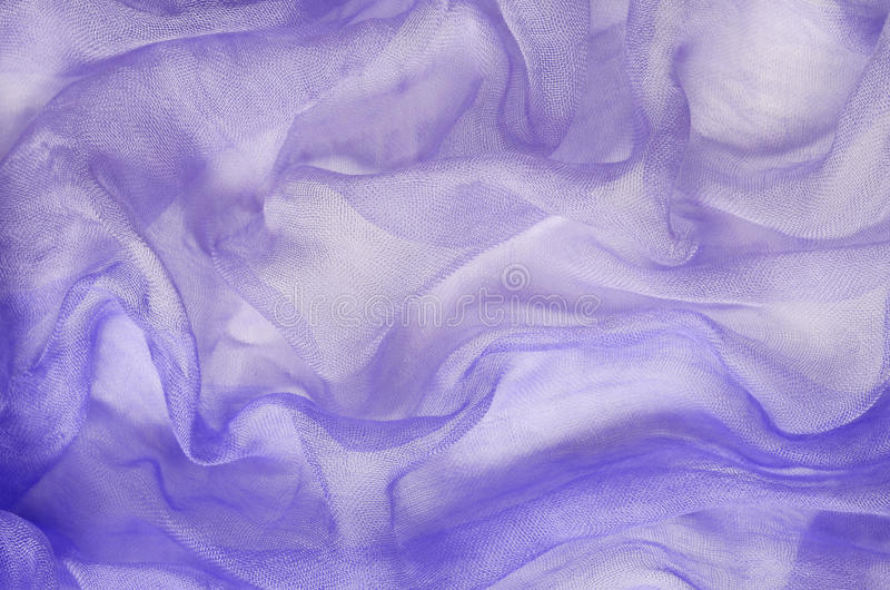 Purple chaotic draped fabric. For background stock photo