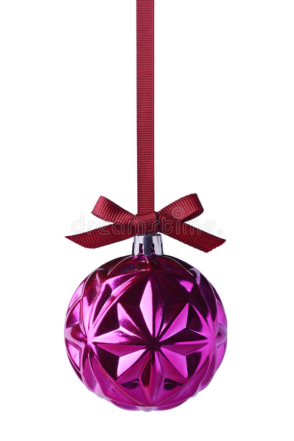 Purple christmas ball with bow hanging on ribbon stock image