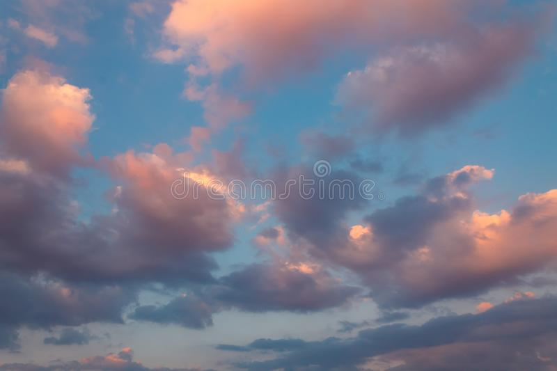 Purple clouds sunset with the sky in background royalty free stock photo