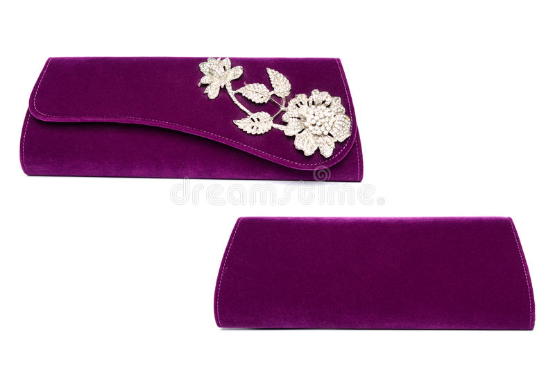 Purple clutch with diamond flower on a white background royalty free stock photo