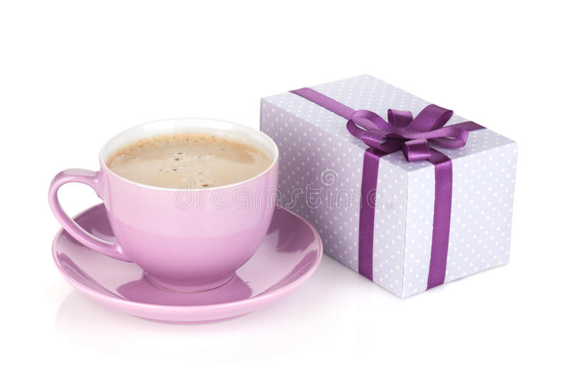 Purple coffee cup and gift box. With bow. Isolated on white background royalty free stock photo
