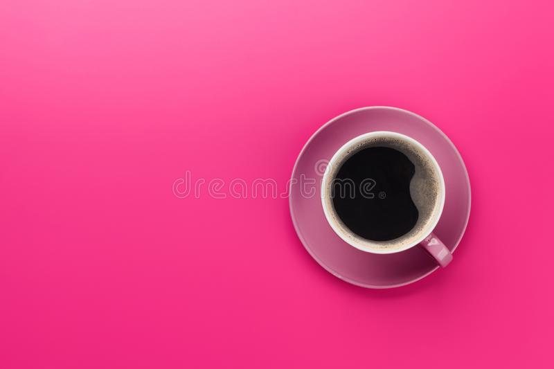Purple coffee cup. Over purple background. Top view flat lay with copy space royalty free stock photos