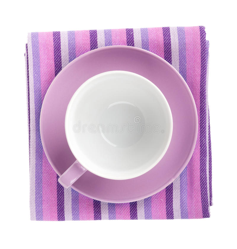 Purple coffee cup over kitchen towel. View from above. Isolated on white background royalty free stock photo