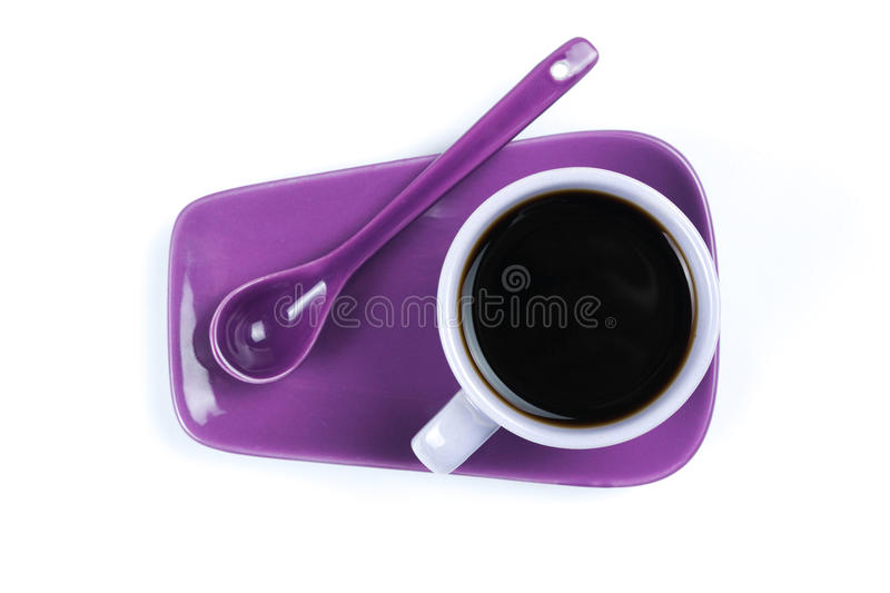 Purple coffee cup with saucer and spoon isolated on white background. Purple coffee cup isolated on white background stock photo