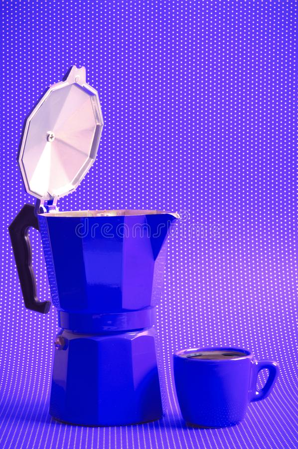 Purple coffee time with moka espresso. Classical italian coffee maker moka espresso and a purple cup over polka dots background