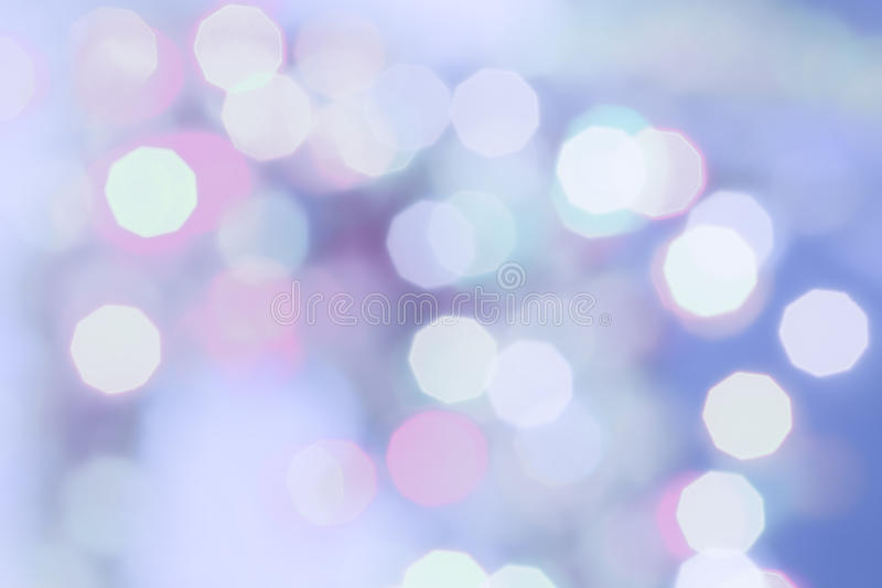 Purple colored Christmas bokeh light abstract holiday background. royalty free stock images