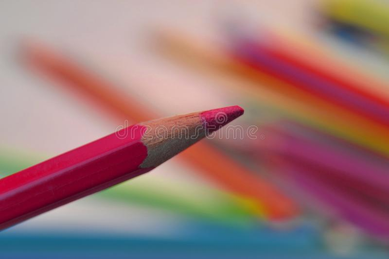 Purple coloured pencil. On colourful background royalty free stock image