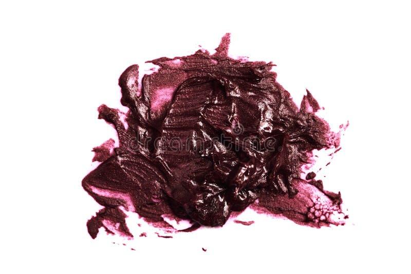 Purple cream shiny Lipstick Sample. Isolated on white Background royalty free stock photography
