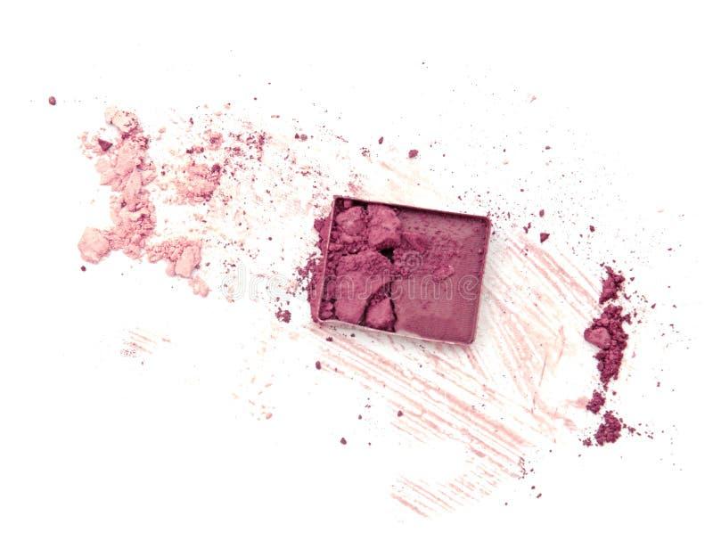 Purple crushed eyeshadow on white background. royalty free stock photos