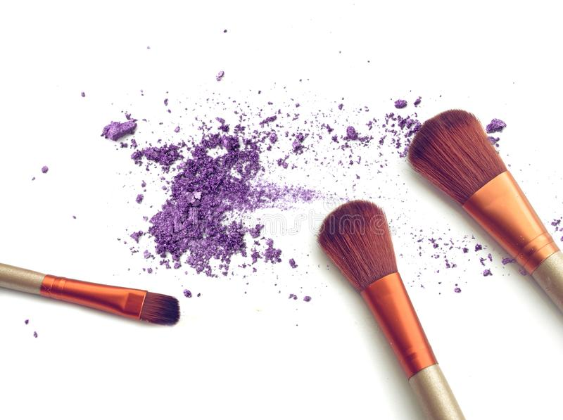 Purple crushed make up color powder and blush. stock photography