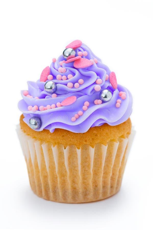 Purple cupcake royalty free stock image
