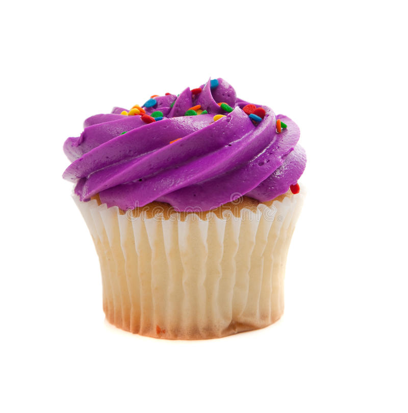 Purple Cupcake with sprinkles on white royalty free stock images