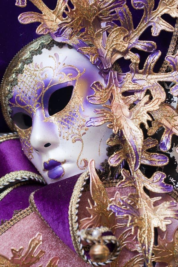 Purple decorative venetian mask royalty free stock images