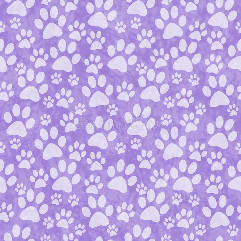 Purple Doggy Paw Print Tile Pattern Repeat Background. That is seamless and repeats royalty free stock photos