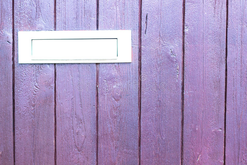 Purple door with letter slot mailbox. Background royalty free stock image