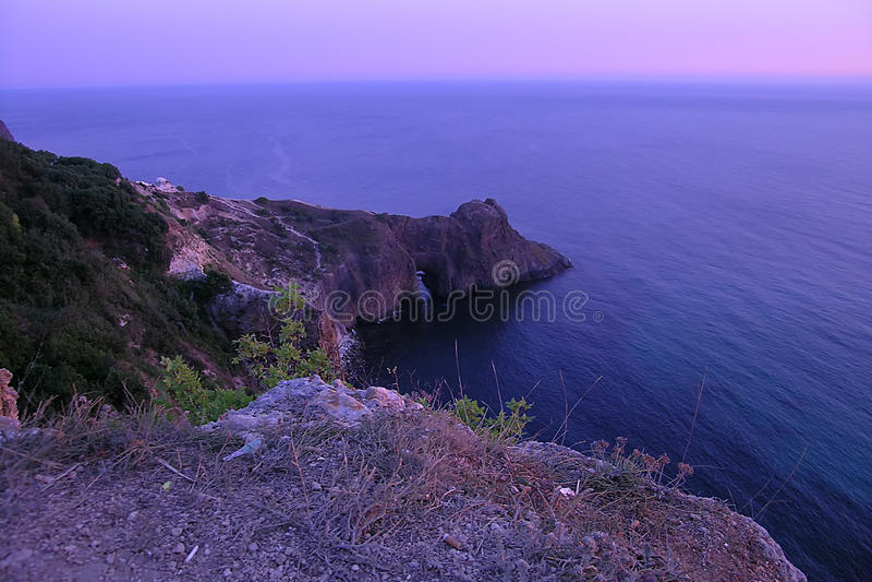 Purple dusk under Fiolent sea. Pink purple dusk under Fiolent Cape sea stock photos