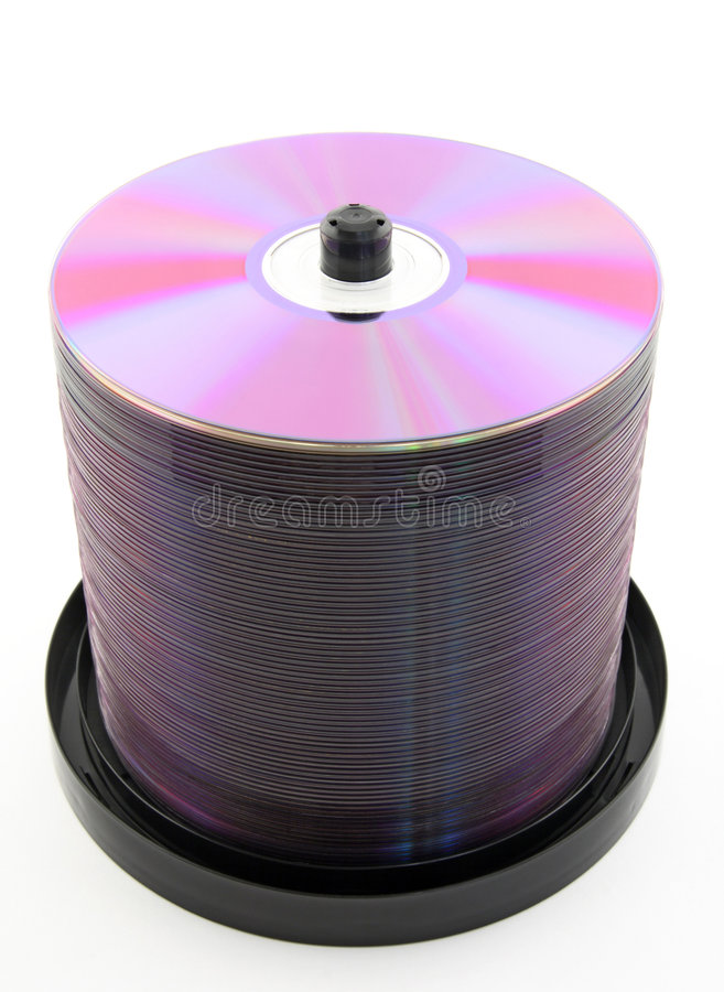 Purple DVDs or CDs on spindle. Colorful purple DVDs or CDs on spindle, on white background. No dust royalty free stock photo
