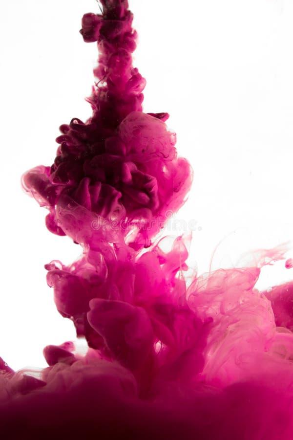 Purple dye in water. Photo stock image