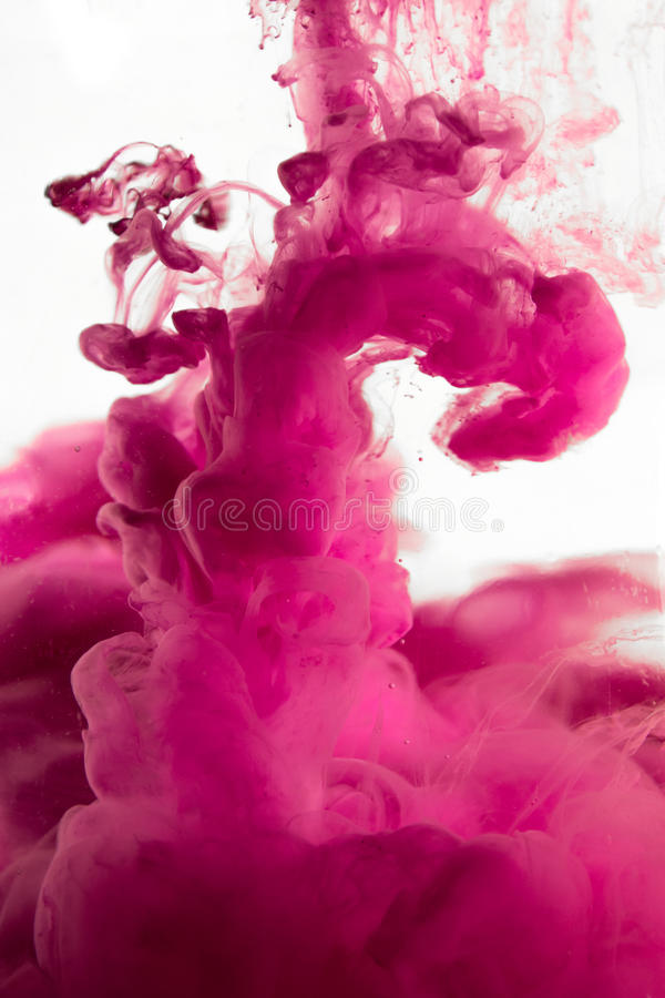 Purple dye in water. Photo royalty free stock photography