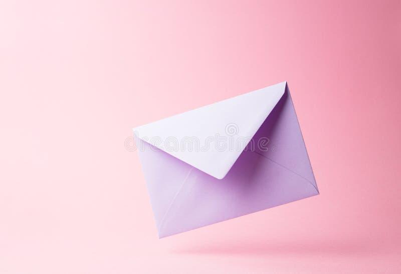 Purple envelope royalty free stock image