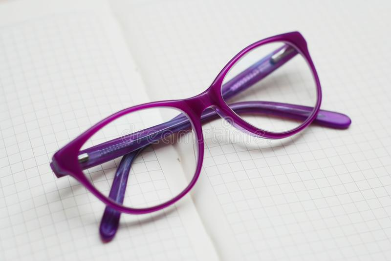 Purple Eyeglasses, Children Spectacles or Glasses on Neutral background royalty free stock photo