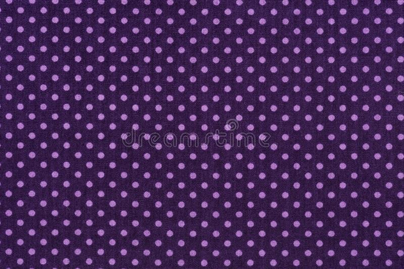 Purple fabric and white tiny polka dots background. stock photos
