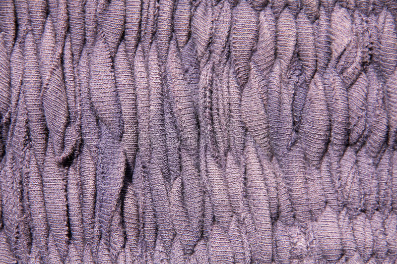 Purple fabrics royalty free stock photo