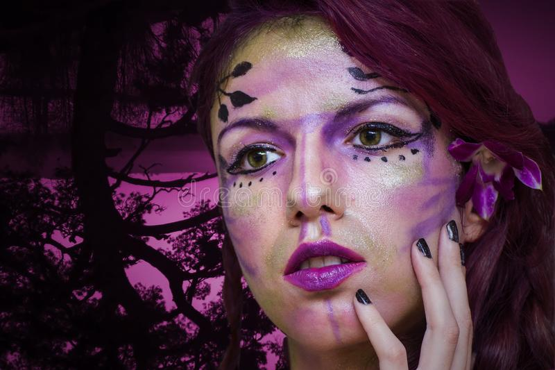 Purple fairy. Make up with a forest background royalty free stock photos