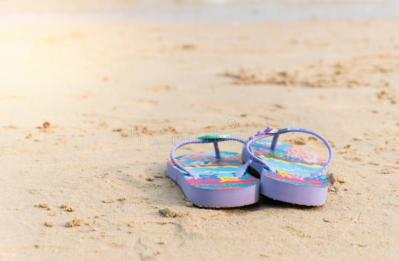 Purple flipflop. On beach royalty free stock photography